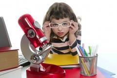 女孩膝上型计算机少许显微镜学员 免版税库存照片