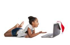 女孩膝上型计算机 免版税库存照片
