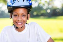 女孩自行车盔甲 库存图片