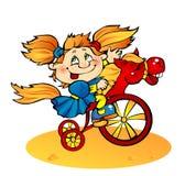 女孩自行车 免版税库存照片
