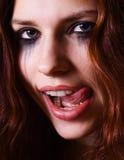 女孩舔嘴唇的她 库存照片