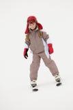 女孩节假日滑雪下来倾斜年轻人 免版税库存图片