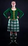 女孩苏格兰男用短裙 免版税库存照片