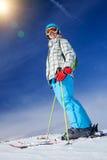 女孩获得在滑雪的一个乐趣 免版税库存照片