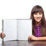 女孩藏品开放书 免版税库存图片