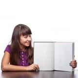 女孩藏品开放书 免版税库存照片