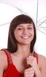女孩藏品微笑的伞年轻人 库存图片