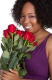 女孩藏品玫瑰 免版税库存照片