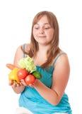 女孩藏品蔬菜 免版税库存图片