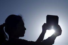女孩藏品镶板太阳 库存图片