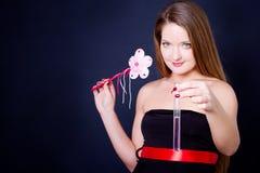 女孩藏品魔术试管鞭子 图库摄影