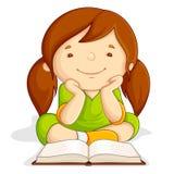 女孩读取开放书 免版税库存照片