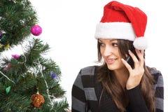 女孩谈话在白色背景隔绝的电话 免版税库存照片
