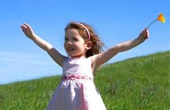 女孩象草的小的草甸 免版税库存照片