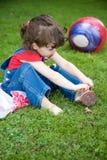 女孩象草的小的草甸 库存照片