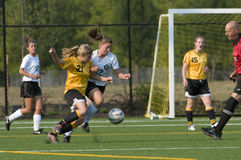 女孩足球大学运动代表队 免版税库存图片