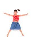 女孩跳一点 免版税库存图片
