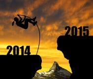 女孩跳到新年2015年 库存照片