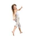 女孩跳少年 免版税库存图片