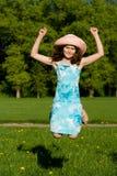 女孩跳本质 免版税库存图片