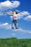 女孩跳的年轻人 图库摄影
