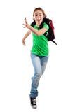 女孩跳的运行的年轻人 库存照片