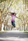女孩跳的非离子活性剂 库存图片