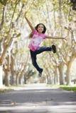 女孩跳的非离子活性剂 免版税库存照片