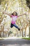 女孩跳的非离子活性剂 图库摄影
