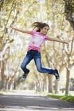 女孩跳的非离子活性剂 免版税库存图片