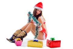 女孩辅助工俏丽的圣诞老人 图库摄影