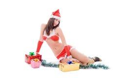 女孩辅助工性感的圣诞老人 免版税图库摄影