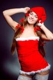 女孩辅助工性感的圣诞老人 库存图片