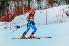 女孩运动员在结束以后下坡在高山滑雪的俄国杯期间 免版税库存图片