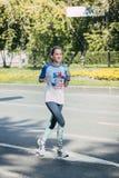 女孩运动员赛跑 免版税库存照片
