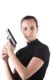 女孩递手枪 免版税库存照片