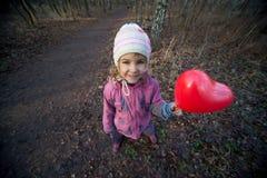 女孩重点可膨胀红色小 库存照片