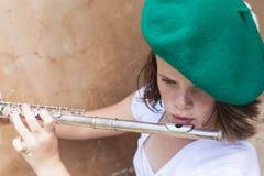 女孩长笛音乐 免版税图库摄影