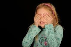 女孩隐藏寻求 免版税图库摄影