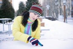 女孩雪写道 免版税库存照片