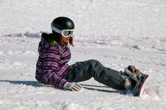 女孩雪板运动年轻人 免版税库存照片
