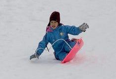 女孩雪橇年轻人 图库摄影
