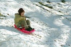 女孩雪橇年轻人 库存图片
