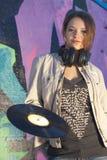 女孩青少年耳机的记录 库存照片