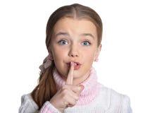 女孩静寂少许显示的符号 免版税库存照片