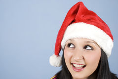 女孩顶头查找的圣诞老人斜向一边 库存照片