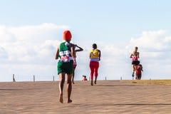 女孩马拉松长跑行动 免版税库存图片