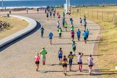 女孩马拉松长跑行动 库存图片