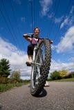 女孩骑马自行车 库存照片
