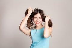 女孩头发做的两尾巴  免版税库存图片